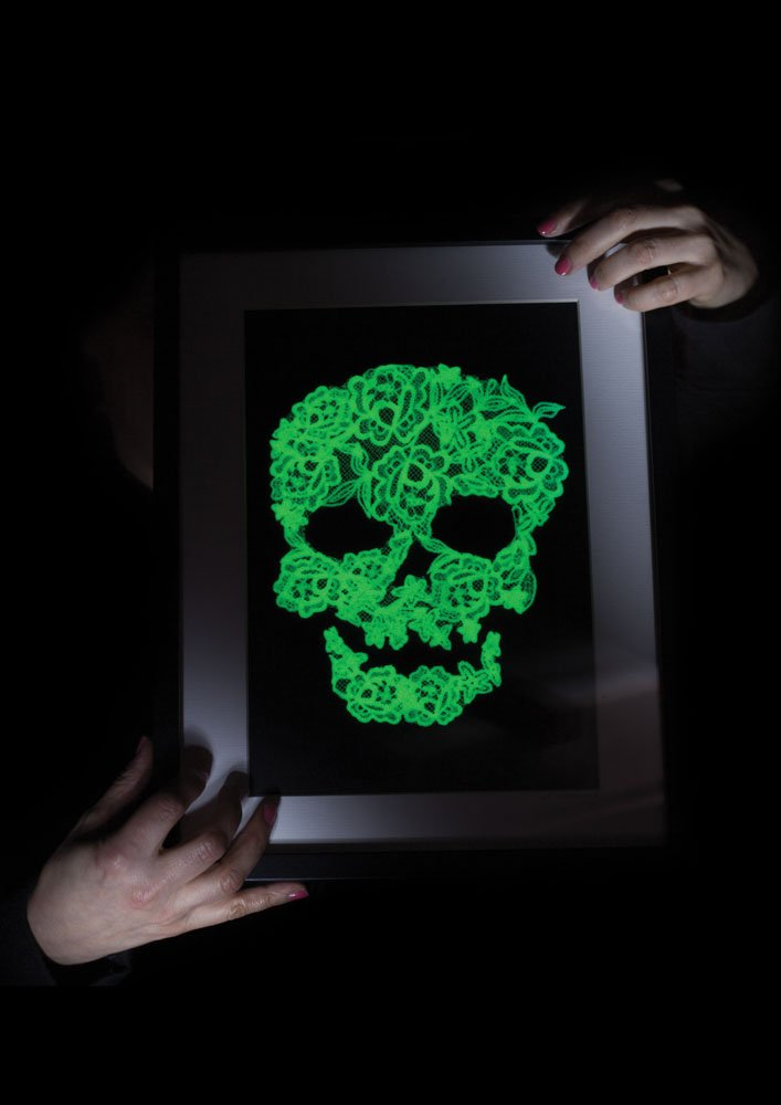 A picture of a glow in the dark lace skull